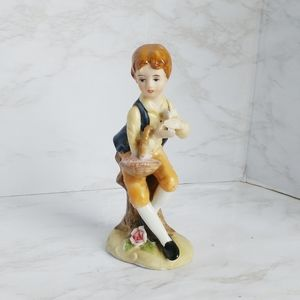 Little Boy Sitting with a Basket Figurine